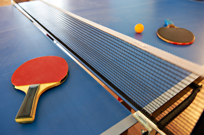 Table tennis rackets and orange ball